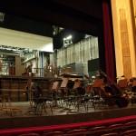 Пока мы ходили на сцену, оркестровая яма поднялась на основной уровень сцены